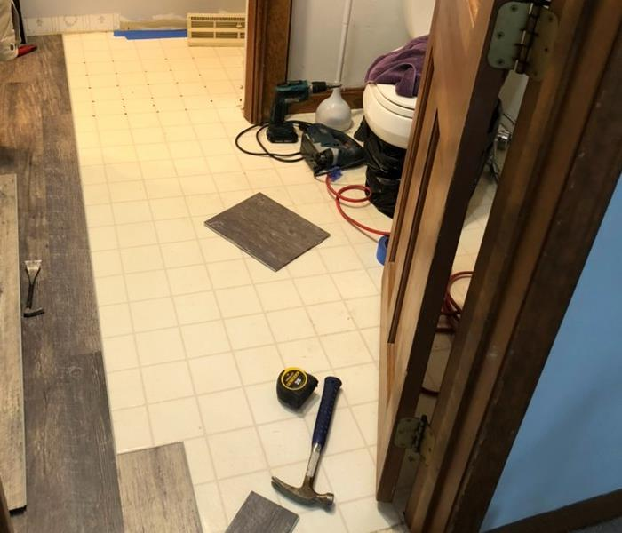 Floor in bathroom before remodel